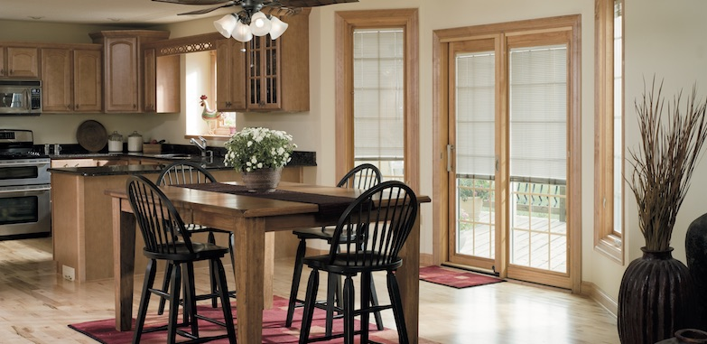 Pella blinds on windows and doors in a kitchen